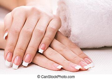 spa, towel., vrouwenhanden