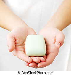 Spa Treatment - Closeup of womans hands holding spa...