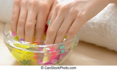 Spa treatment for female hands. Manicured hands in spa salon receiving spa procedure. Spa salon service.