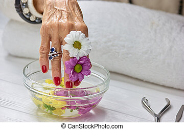 Spa treatment for female hands. Senior woman manicured hand...