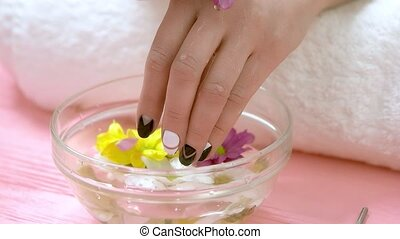 Spa treatment for hands, slow motion. Woman manicured hands,...