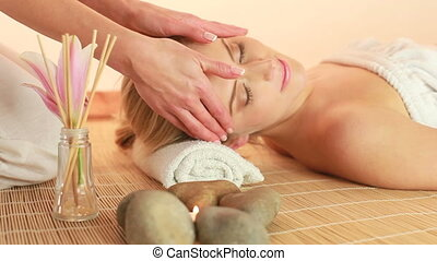 Spa Treatment Head massage high angle view with hands of female masseuse.