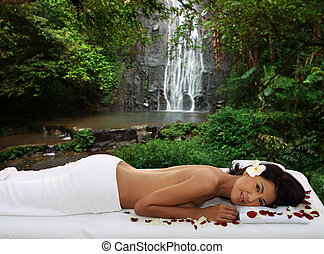 Spa treatment outdoor by waterfall