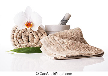 Spa treatment towel orchid pestle and mortar on reflective ...