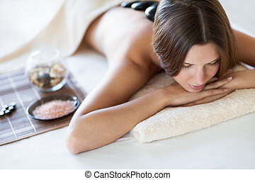 Spa treatment - Young woman at spa salon