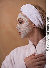 Spa Woman applying Facial Mask