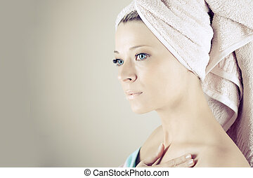 Spa Woman. Beautiful Girl After Bath Touching Her Face. Perfect Skin. Skincare. Young Skin