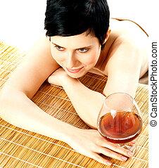 Spa woman hodling wine glass