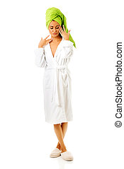 Spa woman standing in bathrobe