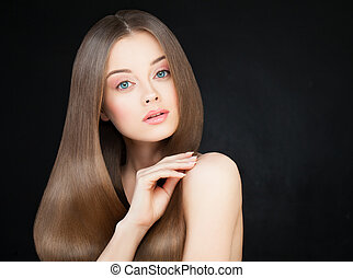 Spa Woman with Long Healthy Hair on Dark. Beautiful Model with Shiny Hairstyle