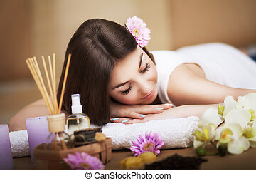 Spa. Women's health. Portrait of a beautiful smiling woman with a fresh face. Soft skin. A healthy happy girl with a natural makeup that relaxes indoors. Beauty, concept of skin care. Spas.