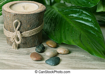 Spa. - Wood candle with stones and leafs.