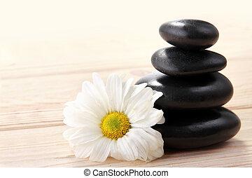 zen basalt stones and flower