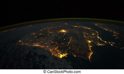 Space flight around Earth at night