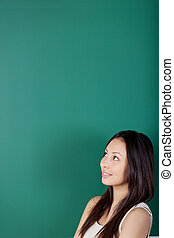 space for new ideas - young woman with blackboard in ...