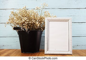 space photo frame with dried flower in metal flower pot