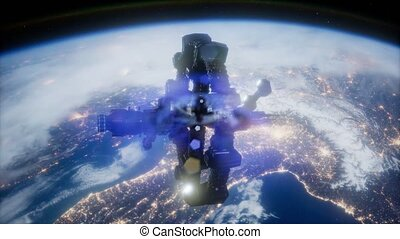 space ship over the earth seen from space.