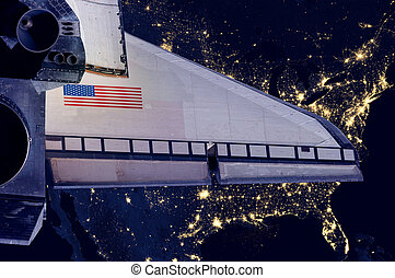 Space Shuttle and aerial night view of the U.S.A.