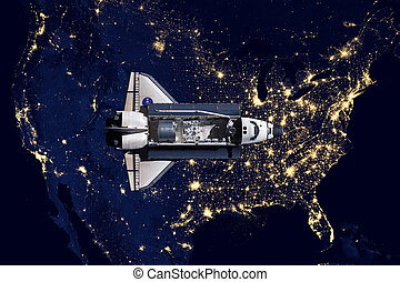 Space Shuttle and aerial night view of the USA