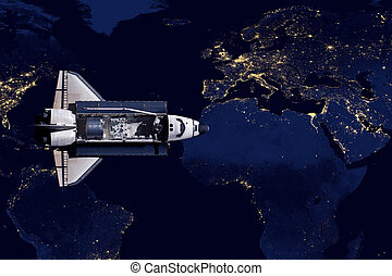 Space Shuttle and aerial night view of the World.