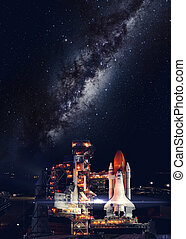 Space shuttle taking off on a mission. Elements of this...