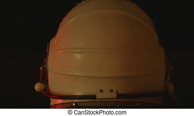 Space Suit Helmet - A white astronaut helmet seen from back,...