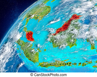 Space view of Malaysia in red