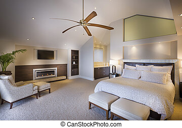Spacious double bed bedroom with a wooden fan photographed in daytime light