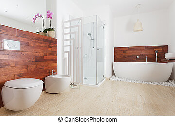 Spacious bright bathroom with shower and bath