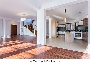 Spacious hall and open kitchen - Horizontal view of spacious...