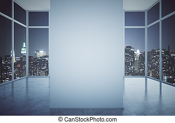 Spacious interior with railing and windows with night city...