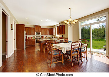 Spacious kitchen room with dining area and walkout deck