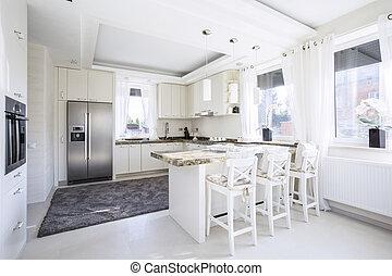 Spacious kitchen with countertop - Spacious, white kitchen ...