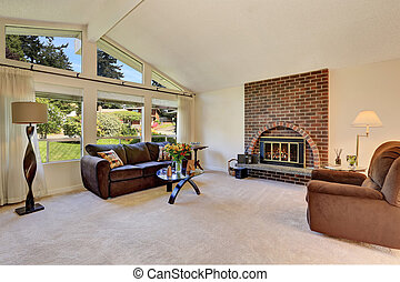 Spacious living room interior with brick fireplace