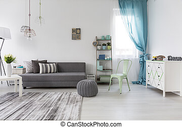 Spacious living room with comfortable couch - Bright...