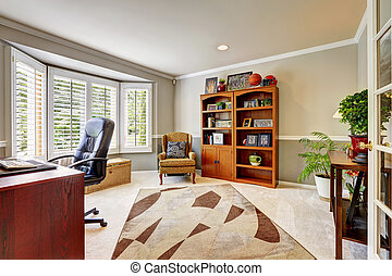 Spacious office room interior with flowers
