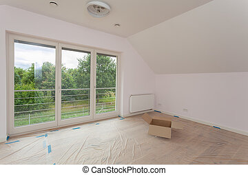 Spacious room being renovated, moving new house