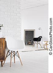 Spacious studio with white brick wall