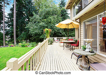 Spacious walkout deck with patio area