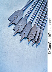 Spade bits for drilling wood on metallic background construction