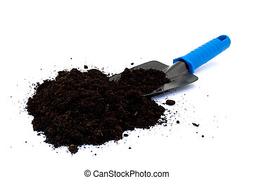 Spade with potting compost - A gardening spade with potting...