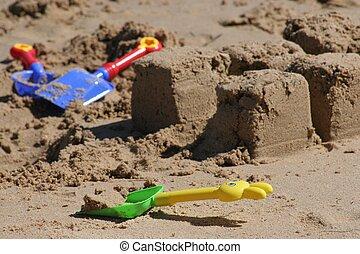 Spades on Beach - Colorful plastic spades in sand on beach