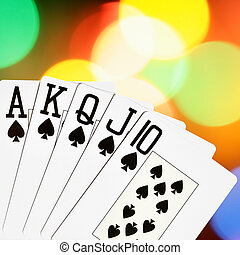 Spades royal flush close-up over colorful background