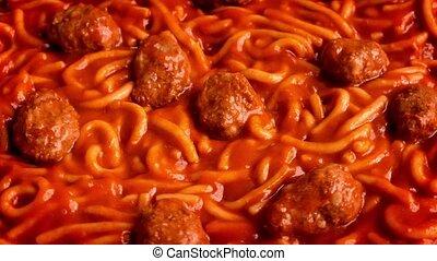 Spaghetti And Meat Balls Turning - Closeup of spaghetti and...