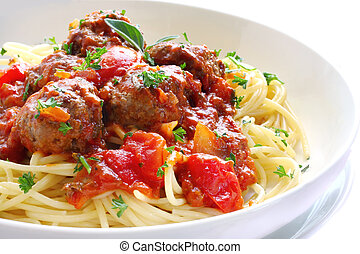 Bowl of spaghetti and meatballs, in a tomato sauce.