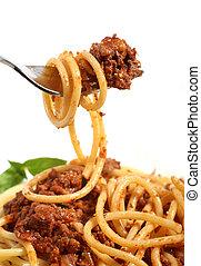 Spaghetti bolognese on a fork - A fork lifting spaghetti...
