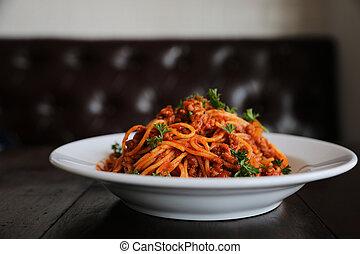 Spaghetti bolognese on wood background , italian food
