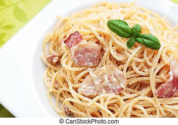spaghetti carbonara. - - plate of spaghetti carbonara with ...
