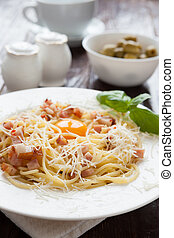 Spaghetti carbonara with grated parmesan cheese