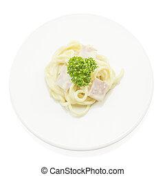 Spaghetti carbonara with ham italian food on top view